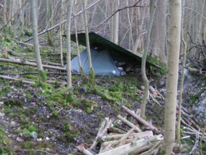 Stealth camping tents with camo tarp
